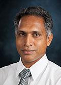 Dr. Oomman K. Varghese